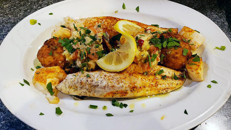 Bronzino with scallops and crab cakes